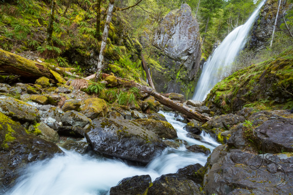 A tall waterfall, flowing toward the viewer | LotsaSmiles Photography