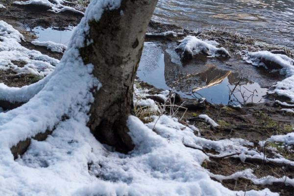A Yosemite peak reflected in a frozen pool | LotsaSmiles Photography
